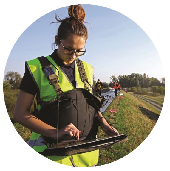 A WOMAN, LEVEES, A LASER SCANNER FOR MEASURING THE STATE OF LEVEES